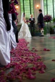 Wedding shot down an aisle.